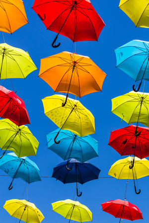 Two hundred colourful umbrellas suspended above a street in Liverpool city centre to raise awareness about ADHT. 写真素材