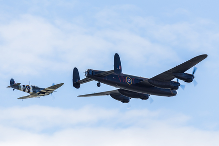 The Lancaster bomber pictured just in front of the Spitfire of the Battle of Britain Memorial Flight at the Blackpool airshow.