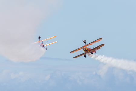 The orange Wingwalker display team prepare to cross one another at Blackpool beach during the annual free airshow held in the town.