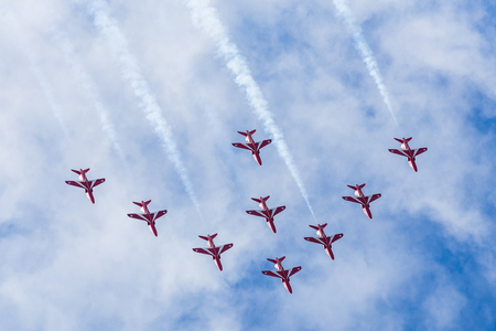 The Red Arrows descend from a loop as they fly in Nine Arrow formation after arriving at the Blackpool airshow.