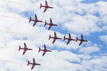 The Royal Air Forces aerobatic display team, The Red Arrows fill the frame as they fly the Concorde Bend at the Blackpool airshow. Editorial