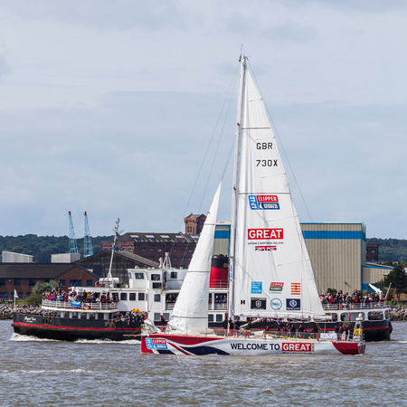 mersey: The Love Great Britain Clipper boat next to the Royal Iris before the start of the Clipper race.Now in its eleventh year, the race sees twelve global teams compete in a 40000 nautical mile around the world race on a 70 foot ocean racing yachts.The teams l
