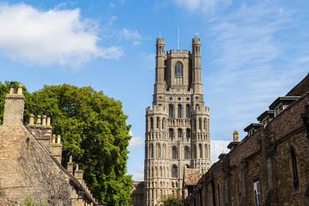 Looking up a traditional street in Ely towards the citys Anglican cathedral. Stock Photo