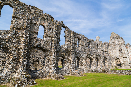 Remains of Castle Acre Priory in the heart of the Norfolk countryside - pictured against a blue sky in the summer of 2017.