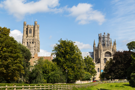 The south facing facade of the Anglican cathedral in Ely seen contrasting against the blue summer skies of Cambridgeshire.