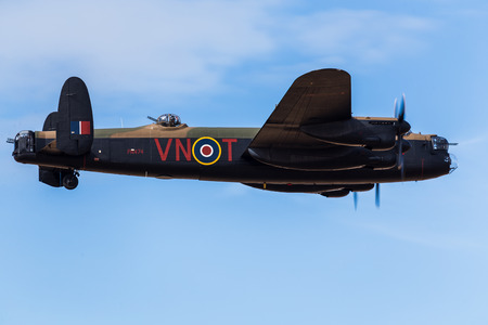 The Lancaster bomber from the Battle of Britain Memorial Flight fills the frame during a display at hte Southport airshow in 2017.