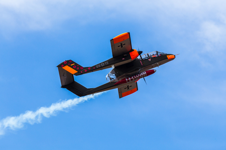 North American Aviation Rockwell OV-10 Bronco in Luftwaffe markings at the 2017 Southport airshow against a blue sky.