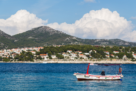 A red and white taxi boat waits off the coast of Jerolim (the closest of the Pakleni Islands to the island of Hvar). Editorial