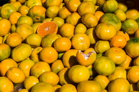 clementines: Locally grown Clementines fill the frame as they sit on a stall in the green market to the east of Splits historical old town. Stock Photo