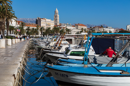 A row of fishing boats moored to the quayside at Matejuska, the Fishermans port of Split in Croatia late one autumn afternoon.