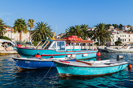 A trio of blue fishing boats moored to the promenade in Hvar Town, the bustling tourist destination on the Adriatic Island circuit.