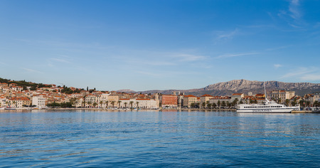 A multiple image panorama taken early one morning from a landing jetty in the port of Split, facing the tree-lined Riva and the Palace of Diocletian.