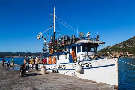 A local trawler selling its fresh catch directly from the boat whilst its moored in Orebic harbour on the Peljesac peninsula.