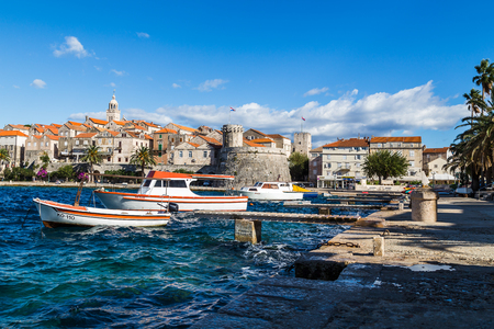 Small boats bob along the choppy waters by Korcula old town on a windswept day on the Croatian island of Korcula during the autumn of 2017.