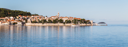 The old town of Korcula, jutting out on its own peninsula, captured from a boat early one morning on the Peljesac channel whilst travelling from the mainland.