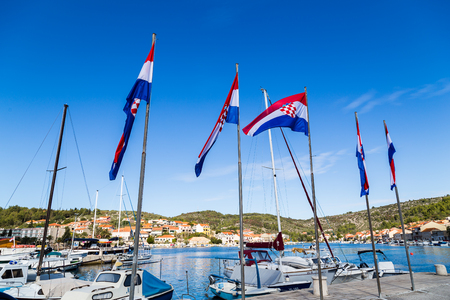 bandera croacia: A quintet of colourful Croatian flags seen on the quay of Vela Luka, a pretty bustling town on the far west end of Korcula Island.