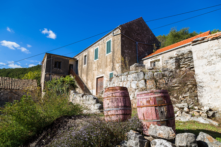 Old barrels seen outside an abandoned house in Smokvica.  This area has a long tradition of wine production and is well known for it's two white wines – Posip and Rukatac.