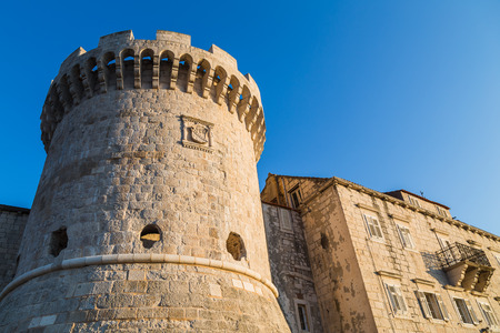 Tower Kanavelic (known as Bokar or Barbarigo Tower) sitting on the Northwest side of Korcula old town's city walls captured in golden sunlight before dusk one autumn evening.
