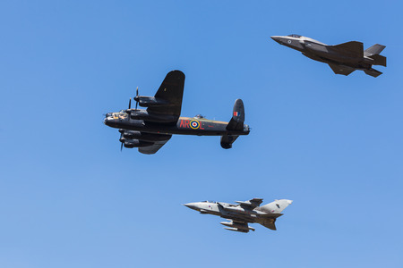 Homage to the Dambusters Squadron featuring the Lancaster bomber, a Tornado GR4 and the new F-35b Lightning II.  Captured at the 2018 Royal International Air Tattoo at RAF Fairford in Gloucestershire. Editorial