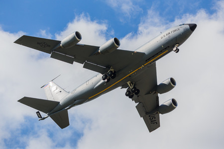 Underside of a KC-135R Stratotanker as it overflies the runway at RAF Mildenhall in Suffolk, seen in April 2019. 写真素材 - 122328103