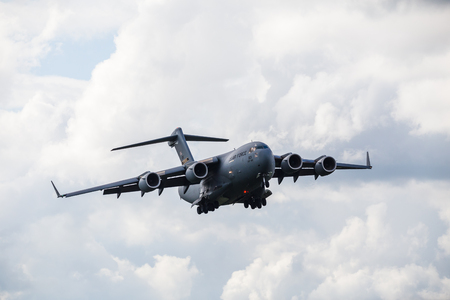 C-17A from the 911th Airlift Wing on final approach with RAF Mildenhall in Suffolk - seen in April 2019. 写真素材 - 122328108
