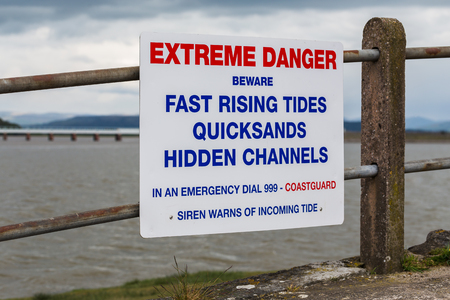 A warning side on the promenade at Arnside in Cumbria where the tide rushes in very quickly.