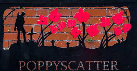 A bench named Poppyscatter in Morecambe.  It is situated in Happy Mount Park (Morecombe) where it sits next to a flower bed where people can scatter poppy seeds to remember those lost during World War