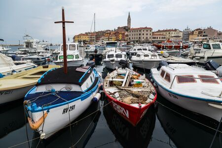The old town of Rovinj on a hilly peninsula, surrounded by boats and the Adriatic Sea - captured in September 2019.