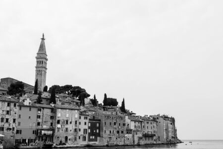 The old town of Rovinj on a hilly peninsula, surrounded by the Adriatic Sea in Croatia.