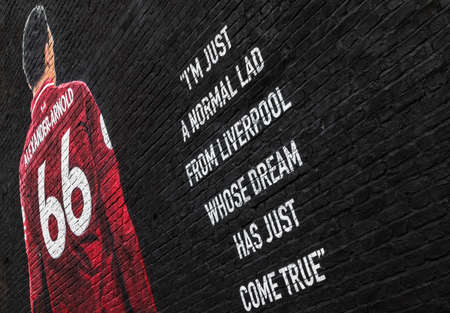 Slanted image of the Trent Alexander-Arnold mural yards away from Anfield stadium (home of Liverpool FC, England) seen in June 2020.