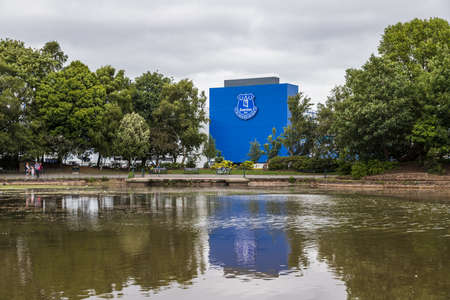 The home of Everton FC (Goodison Park) pictured reflecting in a lake within Stanley Park (England) in June 2020.
