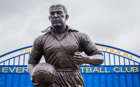Looking up at the Dixie Dean statue in front of the Wall of Fame outside the home of Everton FC in England seen in June 2020.