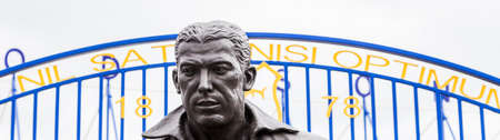 Letterbox crop of the Dixie Dean statue seen outside the home of Everton FC (England) pictured in June 2020. 報道画像
