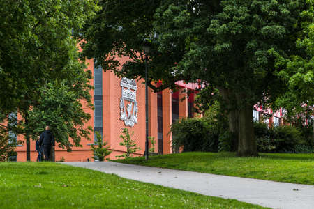 A pathway leads up a hill in Stanley Park in Liverpool (England) to Anfield stadium seen in June 2020.