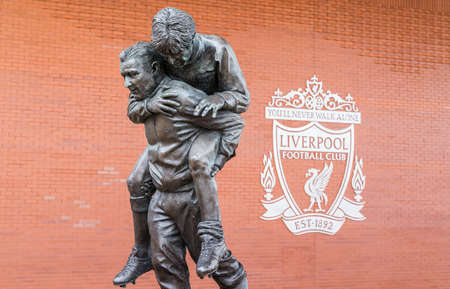 Statue of Bob Paisley carrying Emlyn Hughes seen at Anfield stadium in Liverpool (England) in June 2020.  Paisley is one of the most successful English football managers of all time.