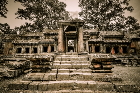 Stone murals and sculptures in Angkor wat, Cambodia the impressive temples near siem reap build by the red khmer civilisation  photo