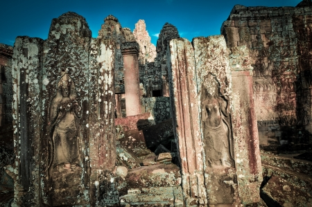 Stone murals and sculptures in Angkor wat, Cambodia the impressive temples near siem reap build by the red khmer civilisation. photo