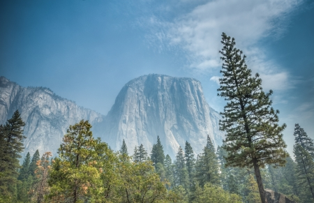 Yosemite mountain with blue sky and trees