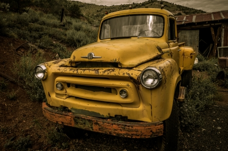 Jerome Arizona Ghost Town mine and yellow old car photo