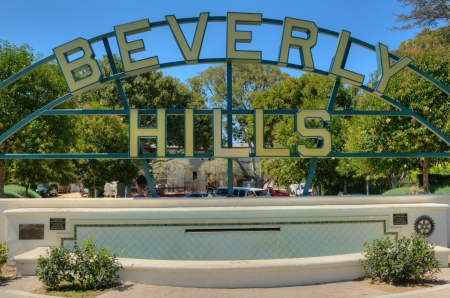 Beverly Hills sign on rodeo drive view into the Los Angeles hills