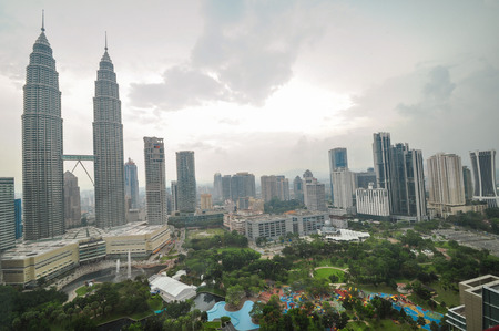 landscape of kuala lumper skyline gardens and petronas towers taken from skybar, Malaysia