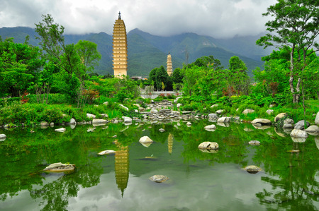 song dynasty: Rebuild Song dynasty town in dali, Yunnan province, China  Three pagodas and water with reflection Stock Photo