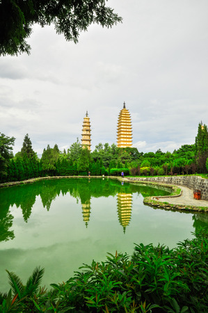 song dynasty: Rebuild Song dynasty town in dali, Yunnan province, China. Three pagodas and water with reflection