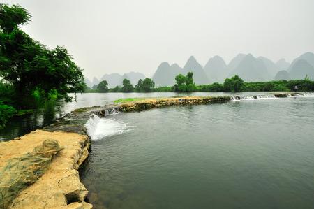 Beautiful Li river side Karst mountain landscape in Yangshuo Guilin, China photo