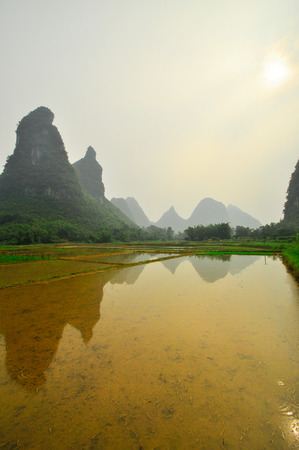 Beautiful Li river side Karst mountain landscape in Yangshuo Guilin, China photo