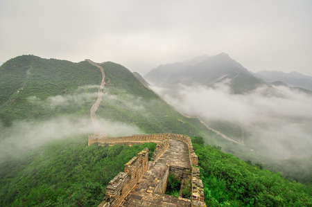 Great Wall fog over mountains in Beijing, China  photo