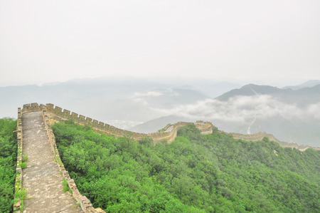 Great Wall fog over mountains in Beijing, China. photo