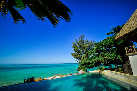 Zanzibar beach and coral rocks bule green ozean Tanzania