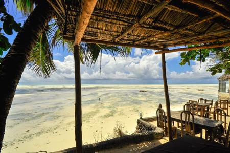 Zanzibar beach and coral , blue ocean, Tanzania photo