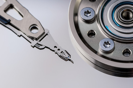 harddrive: HDD Harddisk internals closeup datadisk reader surface